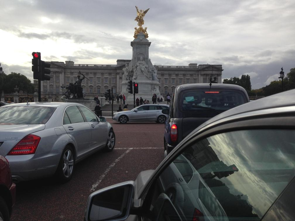 "text from my dad: ""say hello to the queen! that's buckingham palace in back of the queen victoria monument. wonder if anyone every called her tori? taken out window of cab on way to airport. be home soon!"""