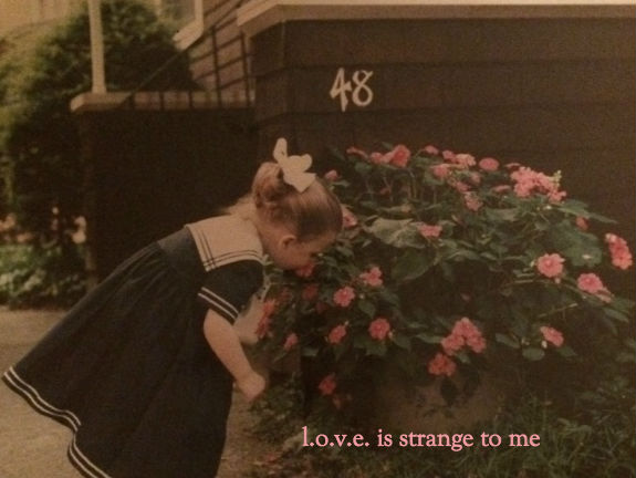 l.o.v.e. is strange to me_cover